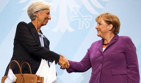 IMF boss throws down gauntlet to Merkel