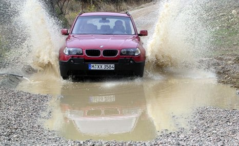 Man blames TV ad for driving BMW into pond