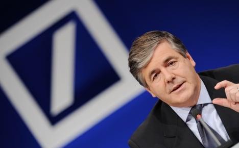 Deutsche Bank profits fall as debt crisis bites