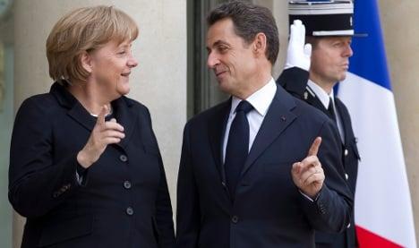 Sarkozy looks to Merkel for re-election help