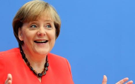 Merkel helps boost conservatives' popularity