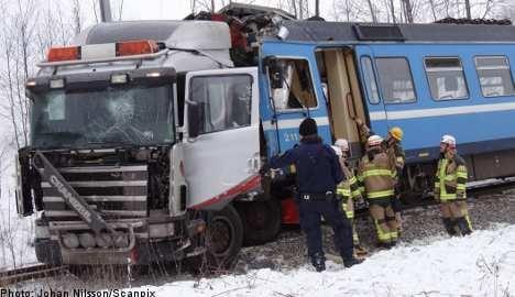 Stockholm train in violent crash with truck