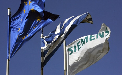 Siemens to forgive Greek debt amid bribery deal