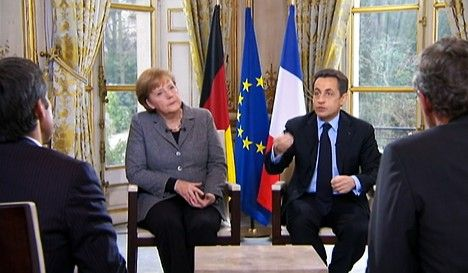 Merkel backs Sarkozy in tough re-election battle