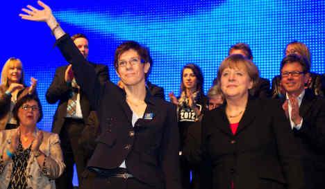 Voters deal Merkel surprise victory