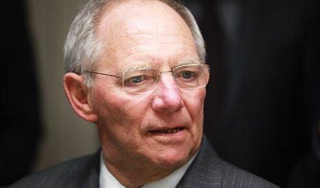 German minister tries to calm Swiss tax row