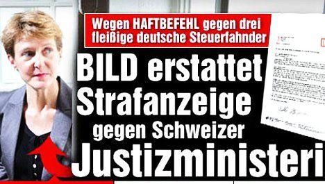 German tabloid sues Swiss minister in tax spat