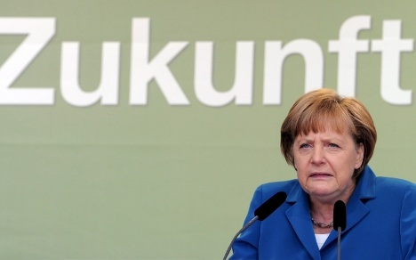 Merkel loses power in state election