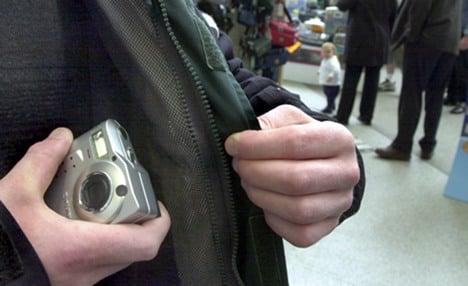 Men in police custody steal cop camera