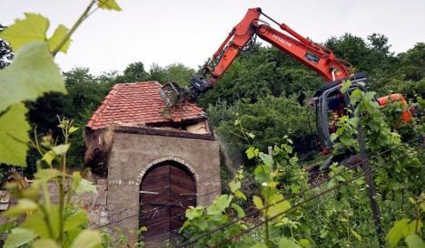 Beekeeper's illegal castle demolished