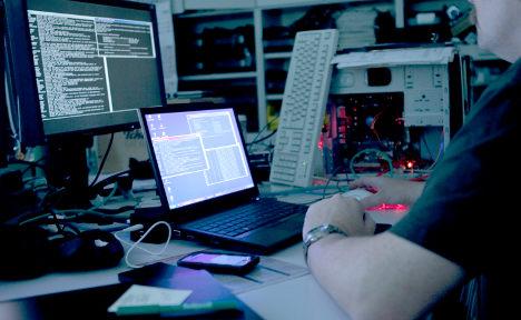 Hacker collective mocks cops after raids