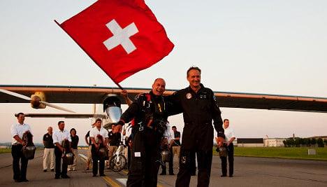 Solar plane returns home after historic flight