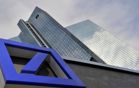 Deutsche Bank cuts 1,900 jobs as profits halved
