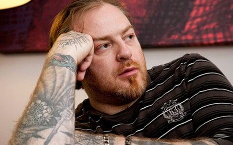 Munich opera defends Nazi tattoo singer