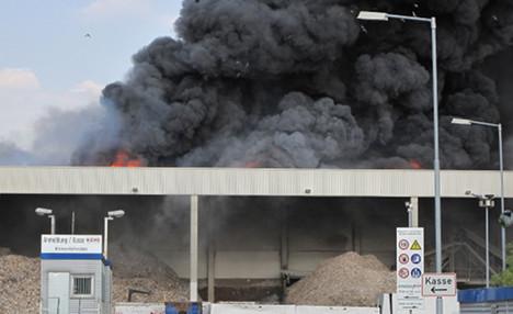 Giant rubbish fire sends smoke over Cologne