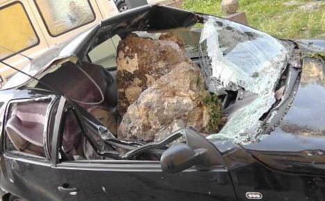 Woman cheats death as rock destroys car