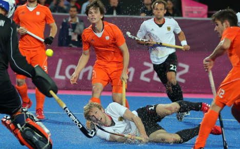Germany fights hard to defend hockey gold