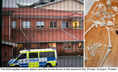 Woman held after human bones found in her flat