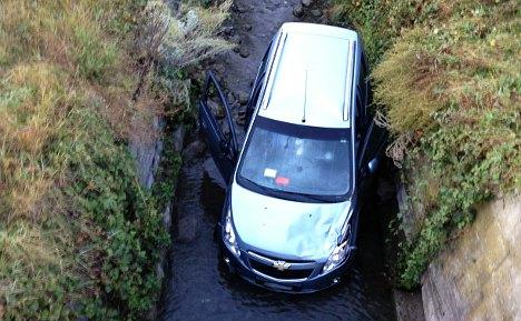 Motorist survives van rollover into river