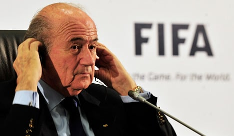 Embattled Blatter vows to see out FIFA term
