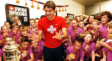 Federer beats battling Bellucci in Basel