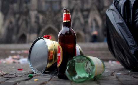 Woman fined for clearing bottles near playground