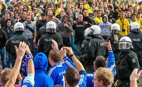 Police arrest 200 football fans after riots