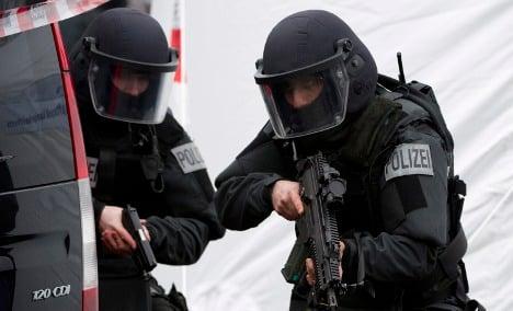 Armed SWAT unit storm wrong flat