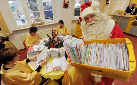 Santa's helpers await Christmas wish lists