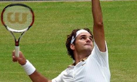 Federer win sets up showdown with Djokovic