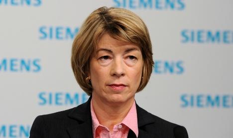 Siemens cuts woman who broke glass ceiling