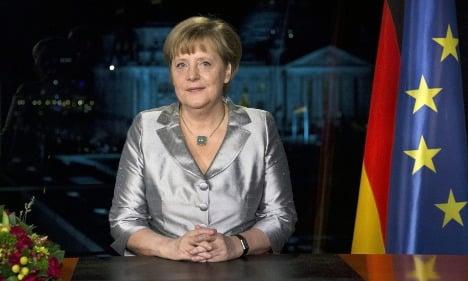 Merkel warns of tougher times ahead