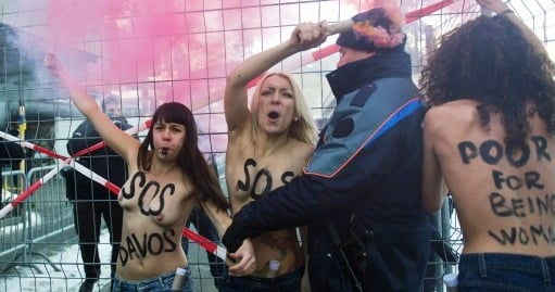Topless feminists protest against Davos forum