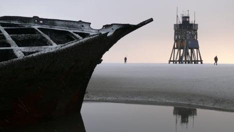 Centuries-old shipwrecks emerge from sandbank