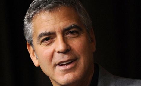 Clooney baffles Berliner by paying dinner bill