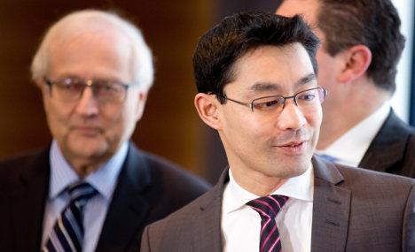 Rösler safe after wrong-footing FDP rival