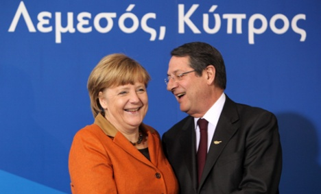 Merkel to Cyprus: Keep reforms on track