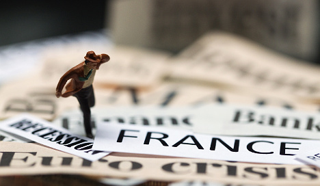 France mired in mild recession: central bank