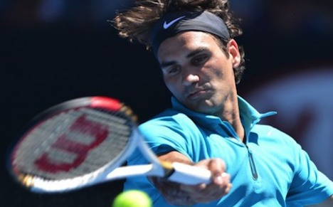 Federer breezes into Melbourne quarter-finals