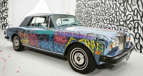 Man Utd great Cantona auctions Rolls Royce