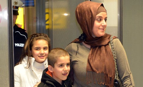 Woman returns 8 years after shock deportation