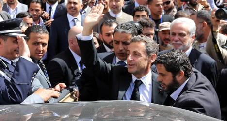 Sarkozy greeted as a hero on return to Libya