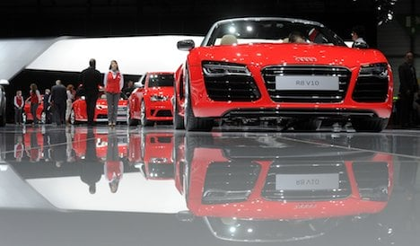 Carmakers cruise past Europe's crisis