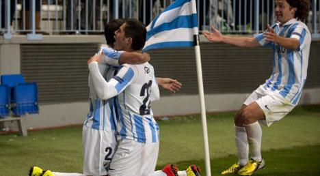 Newcomers Málaga storm into quarter-finals