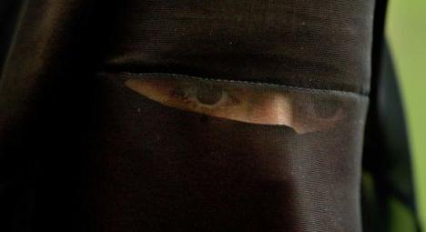 Fine for 'vigilante' who tore veil off Muslim