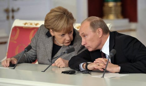 Merkel 'should push Putin for reforms'