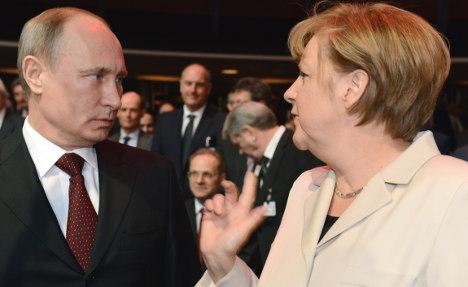 Merkel tells Putin: Give NGOs a chance