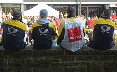 Union delivers postie pay rise after marathon talks