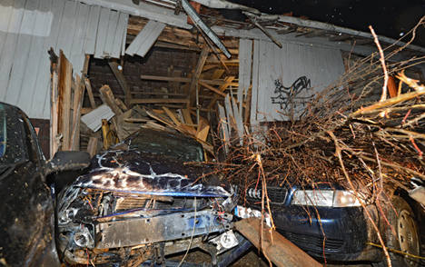 Airborne car smashes through barn