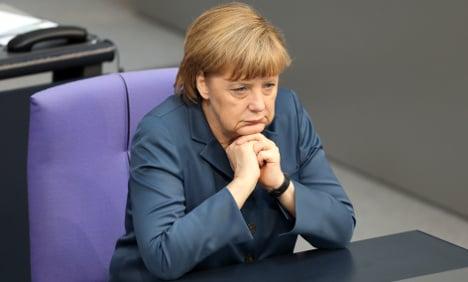 Merkel quashes revolt over female exec quota